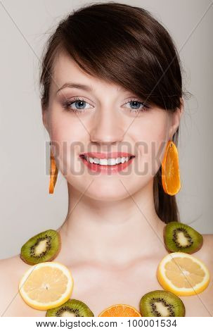 Diet. Girl With Necklace Of Fresh Citrus Fruits