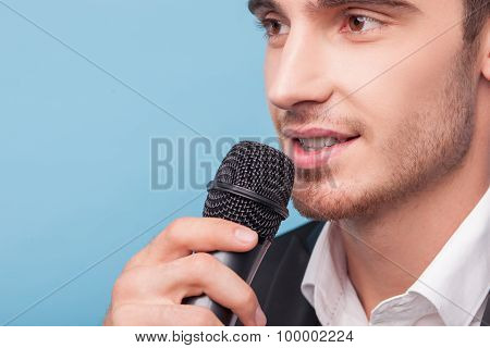 Cheerful young male reporter is telling news