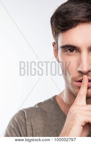 Attractive fit young man has a big secret