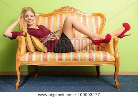 Fashion Woman Laying On Sofa With Pc Tablet.