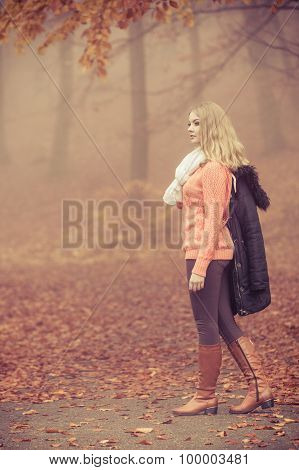 Fashion Blonde Woman With Jacket In Autumn Park.