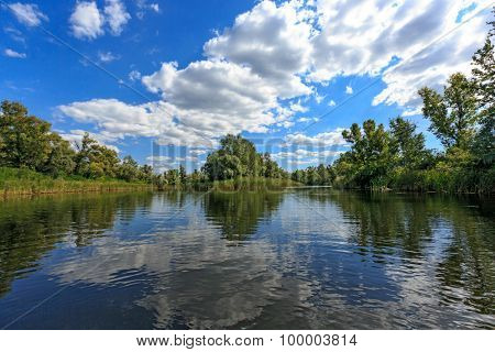 Summer scene on lake with nice clouds in sky