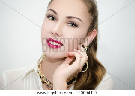 Beautiful girl with pink lipstick