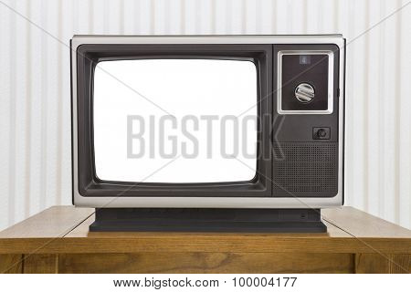 Old analogue portable television on table with cut out screen.