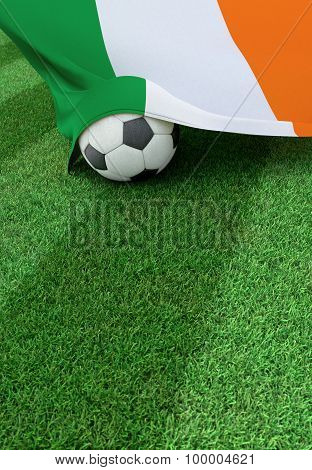 Soccer Ball And National Flag Of Ireland,  Green Grass