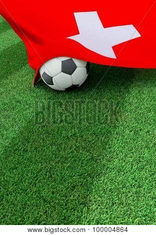 Soccer Ball And National Flag Of Switzerland,  Green Grass