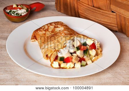 pancake with chicken, tomatoes, peppers, cucumbers and mayonnaise in a still life rural rustic