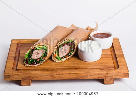 vegetarian falafel shawarma on the board with sauce isolated on a white background poster
