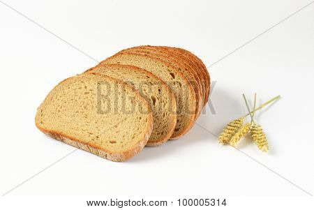 close up of sliced bread on white background
