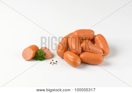 pile of raw sausages on white background