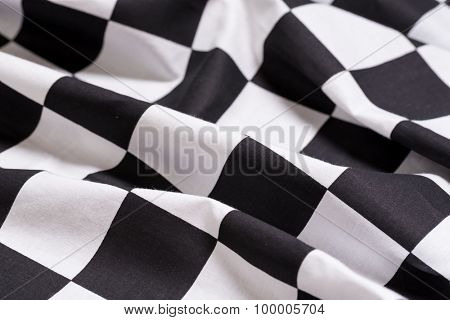 A black and white checkered flag background - motorsport racing- symbol for victory or winning