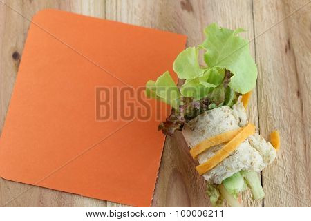 Roll Salad And Note Paper.
