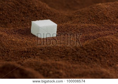 Sugar cube in lots of coffee looking like valleys and mountains