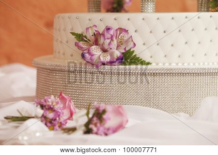 White Wedding Cake Decorated With Flowers And Set Of Cutters