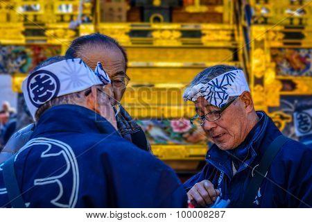 Discussion among elders before Japanese festival (matsuri)