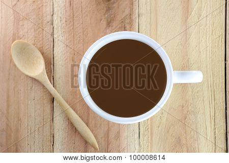 White Coffee Cup And Wooden Spoon.
