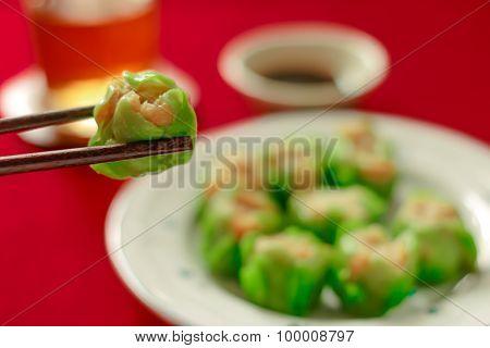 Close Up Using Chopsticks Hold Chinese Dumpling.