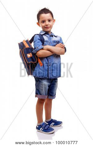 School kid standing with arms crossed on white background