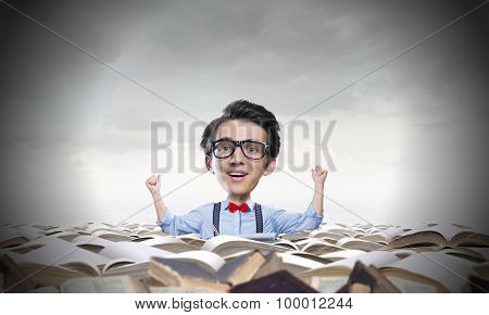 Funny man in glasses with big head among pile of old books