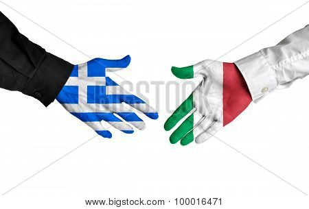 Greece and Italy leaders shaking hands on a deal agreement
