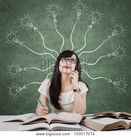 Female Learner And Branchy Light Bulb