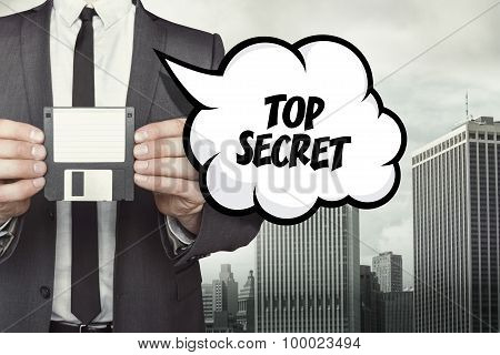Top secret text on speech bubble with businessman holding diskette