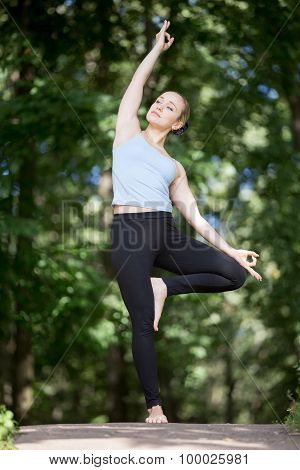 Blond Young Woman Doing Variation Of Vrksasana