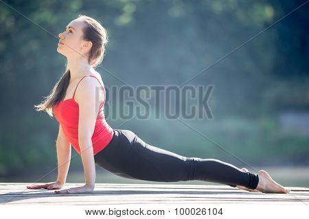 Teenage Girl In Upward Facing Dog Pose