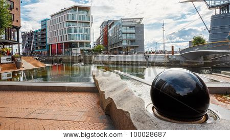 OSLO, NORWAY - JULY 31, 2014: Typical Example Of Scandinavian Architecture. Exterior Building in Aker Brygge is a popular area for for shopping, dining, and entertainment in Oslo, Norway poster