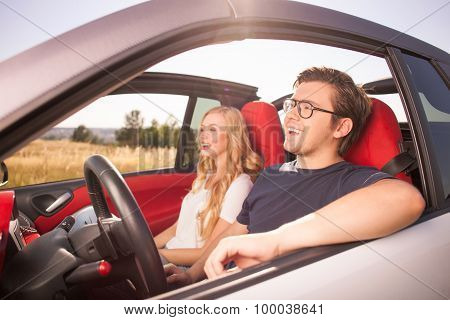 Cute loving couple is traveling by their transport