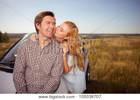 Cute young lovers are traveling by car