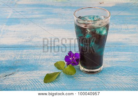 Pea Water on wooden blue.