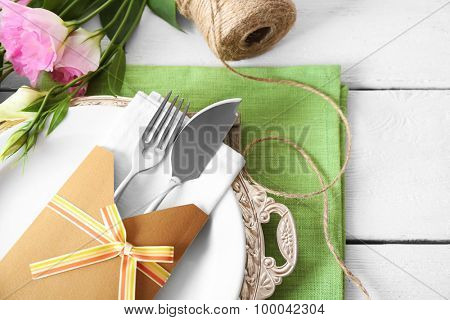 Table setting with spring flowers, close-up