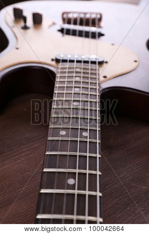 Electric guitar on wooden table close up