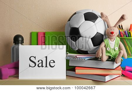 Goods for sale, on light wall background
