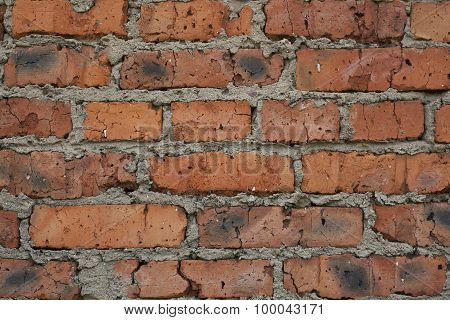 Old brick wall with the damaged surface, texture