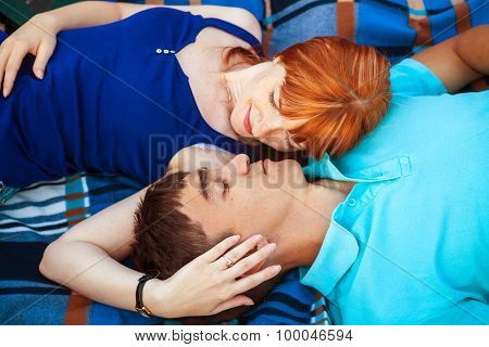 Young Couple Lying On The Plaid In The Park, Close-up View From Above