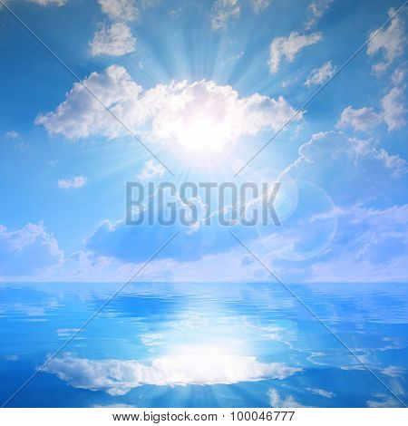 Sunny sky with clouds above a water level