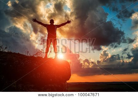 One Guy Standing On A Rock