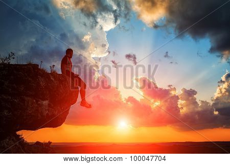 One Guy Sits On A Rock