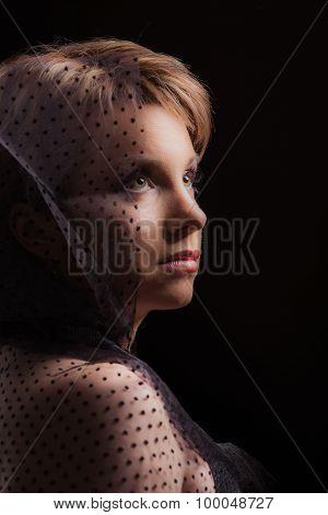 Lovely woman on dark background