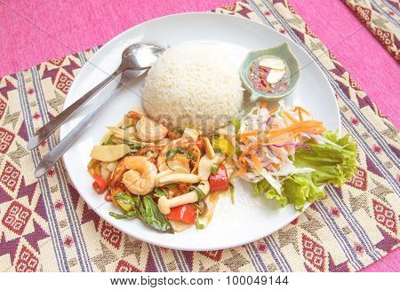 Stir-fried Shrimp With Holy Basil And Rice Set Serve With Fish Sauce Mixed With Red Chili And Lime .