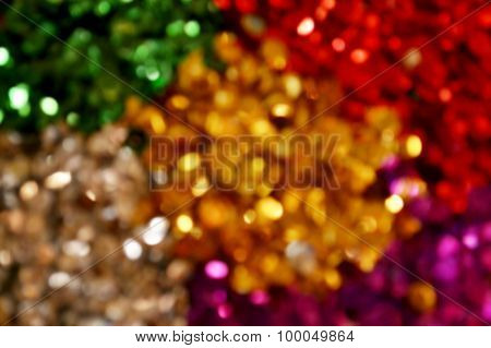 Bright and abstract blurred colorful rainbow background with shimmering glitter