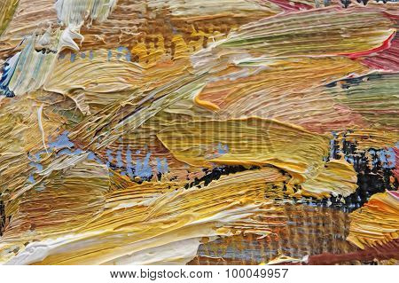 Multi-colored brush strokes of oil paint on canvas