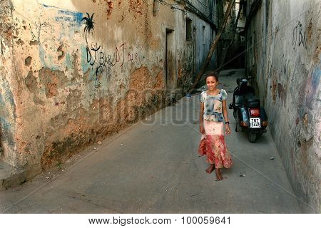 Arab Girl With Colorful Dress, Standing In Courtyard Dilapidated House