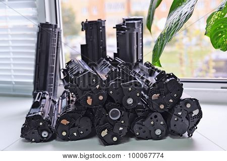 Cartridges From The Printer Stacked On The Windowsill Office