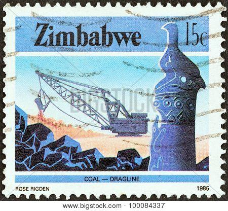ZIMBABWE - CIRCA 1985: A stamp printed in Zimbabwe shows Dragline coal mining