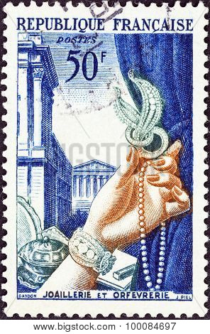 FRANCE - CIRCA 1953: A stamp printed in France shows Gold plate and jewellery