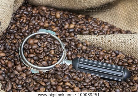 arm of coffee machine in coffee beans