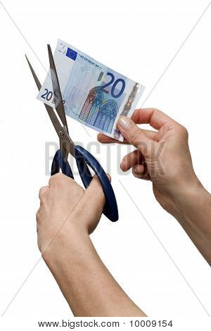 hands cutting one banknote with scissors isolated on white background